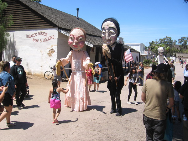 Giant puppets representing Emily Dickinson and Edgar Allan Poe roam Old Town San Diego State Historic Park during 2019 TwainFest!