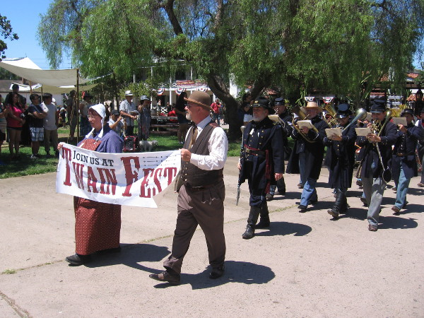 A noon parade circles the Old Town plaza during 2019 TwainFest, where great writers and reading are celebrated!