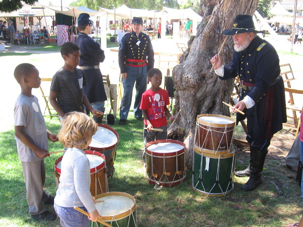 Kids were learning how to play drums and the fife.