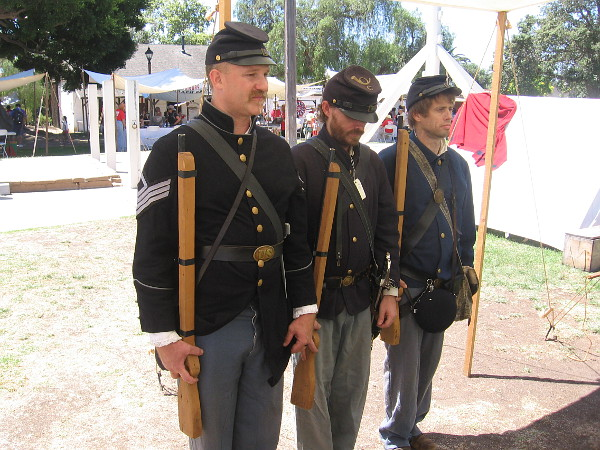 Union soldiers in uniform appear at attention.