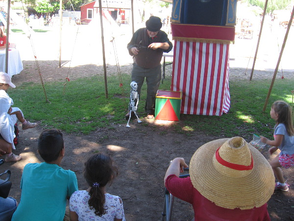 A puppet show delights kids in Old Town's plaza.